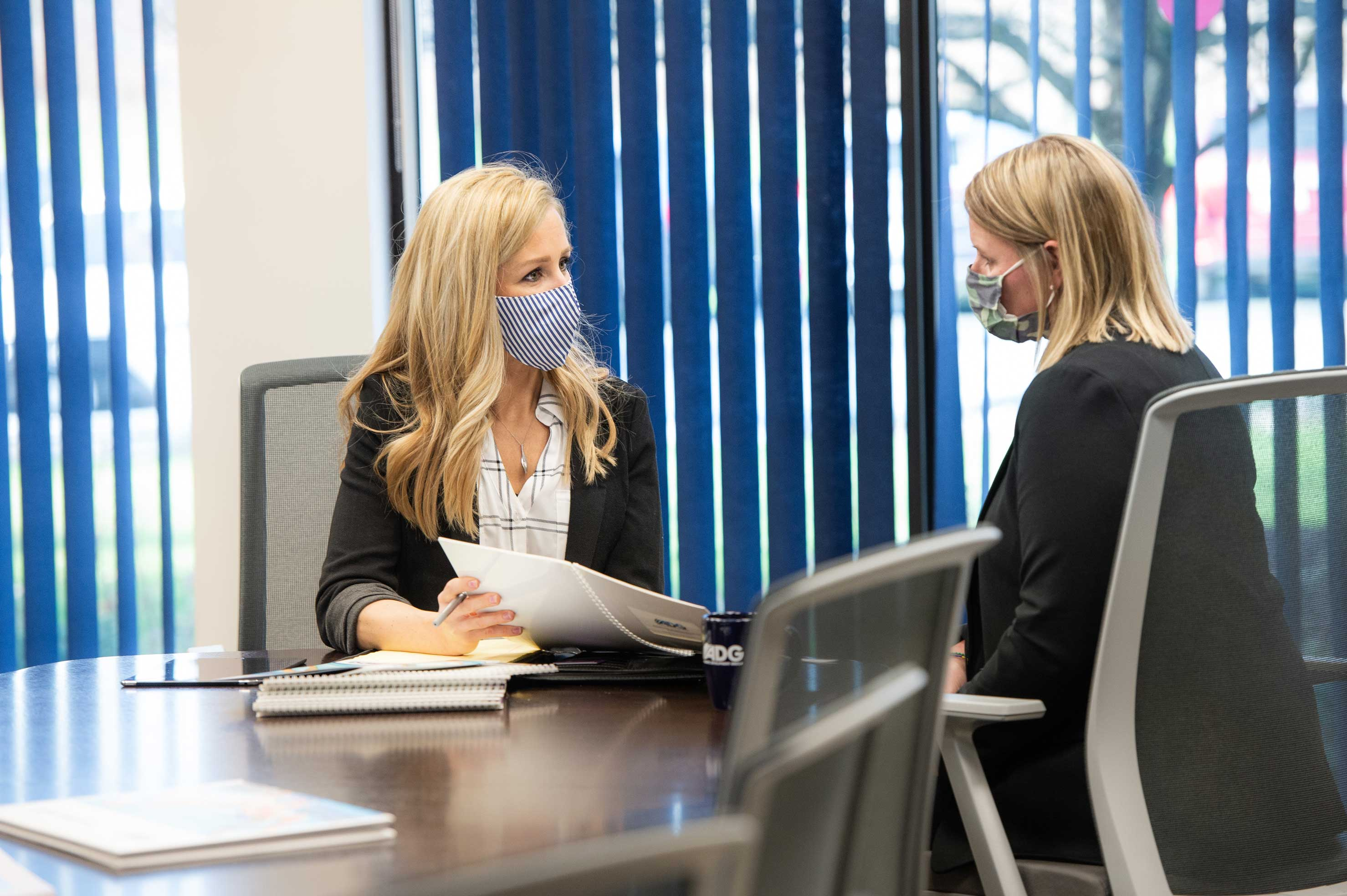 BST Advisor with client wearing face masks and sitting at a conference table